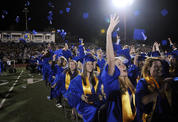 Graduates toss their caps in the air after the Broomfield High graduation Saturday night at Elizabeth Kennedy Stadium.<br /> May 22, 2010<br /> Staff photo/ David R. Jennings