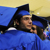 Elie Eias, center, tries to hold back tears while hugging fellow graduates John Guardado, left, and Caitlin Updyke before Saturday night's Broomfield High graduation at Elizabeth Kennedy Stadium.<br /> May 22, 2010<br /> Staff photo/ David R. Jennings