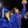 Robin Hinton hits a beach ball back to fellow graduates after the Broomfield High graduation at Elizabeth Kennedy Stadium on Saturday.<br /> May 22, 2010<br /> Staff photo/ David R. Jennings