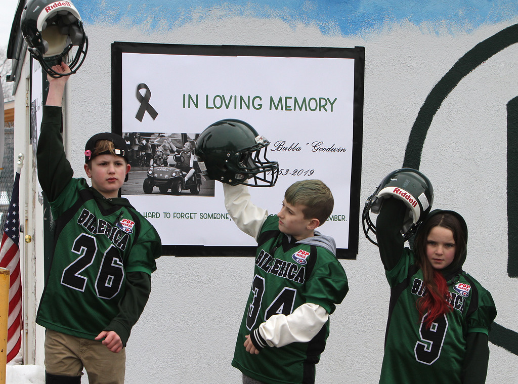 """. Current and former participants in Billerica youth sports assemble at Lampson Field to honor the late Daniel \""""Bubba\"""" Goodwin as his funeral procession passes. From left, Jake Giordano, 10, of Billerica, Dayton Jackson, 9, of Hanscom AFB, and Hailey Bornstein, 8, of Billerica. (SUN Julia Malakie)"""