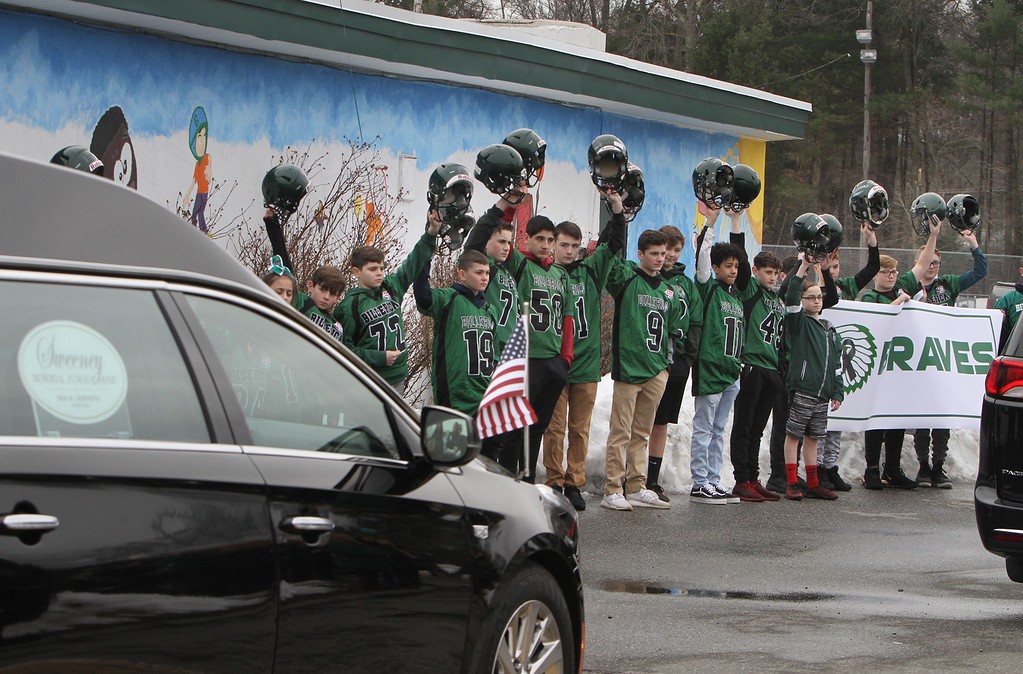 """. Current and former participants in Billerica youth sports assemble at Lampson Field to honor the late Daniel \""""Bubba\"""" Goodwin as his funeral procession passes. (SUN Julia Malakie)"""