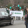 """Current and former participants in Billerica youth sports assemble at Lampson Field to honor the late Daniel """"Bubba"""" Goodwin as his funeral procession passes. (SUN Julia Malakie)"""