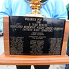 """Current and former participants in Billerica youth sports assemble at Lampson Field to honor the late Daniel """"Bubba"""" Goodwin as his funeral procession passes. Billy Burrows of Loxahatchee, Florida, holds the championship trophy of the Pop Warner team he was on, coached by Bubba Goodwin. (SUN Julia Malakie)"""