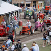 Record-Eagle/Jan-Michael Stump<br /> A tractor parade makes its way though the grounds of the Buckley Old Engine Show on Saturday.