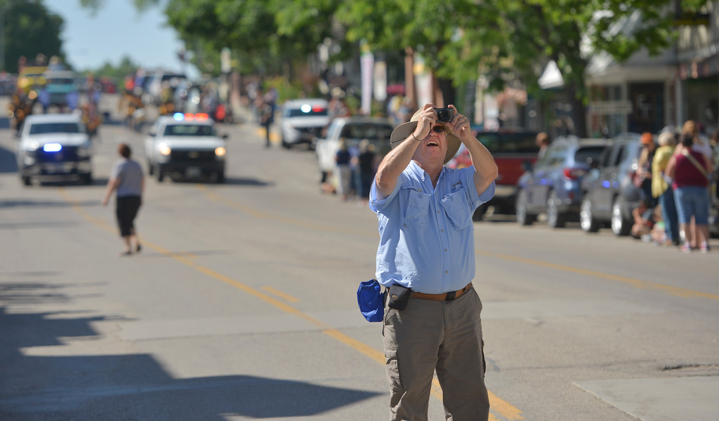 Justin Sheely | The Sheridan Press <br /> A fan snaps a picture up the street of the parade during the sixth annual Longmire Days Saturday on Main Street in Buffalo, Wyoming. The show is based on local author Craig Johnson's novels set in the fictional town of Durant, inspired by the town of Buffalo. Longmire's sixth and final season will be on Netflix sometime this year.