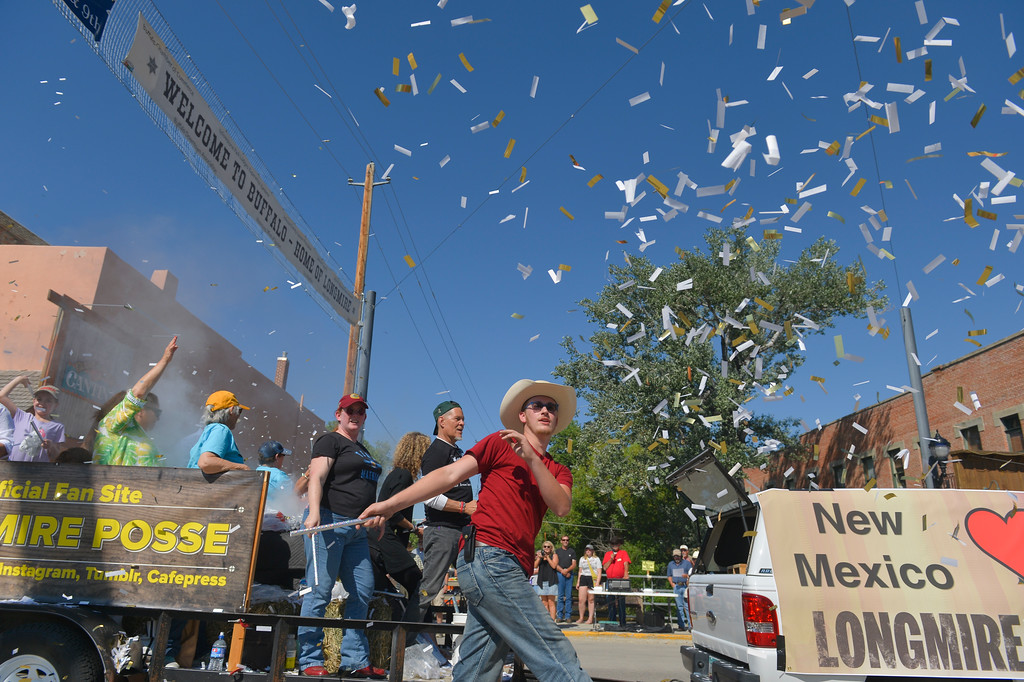 Justin Sheely | The Sheridan Press <br /> Longmire Posse members toss confetti in the air in the parade during the sixth annual Longmire Days Saturday on Main Street in Buffalo, Wyoming. The show is based on local author Craig Johnson's novels set in the fictional town of Durant, inspired by the town of Buffalo. Longmire's sixth and final season will be on Netflix sometime this year.
