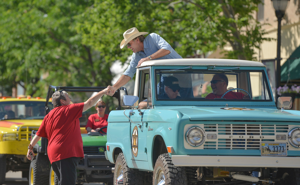 Justin Sheely | The Sheridan Press <br /> A fan greets Robert Taylor, Sheriff Walt Longmire, at the parade during the sixth annual Longmire Days Saturday on Main Street in Buffalo, Wyoming. The show is based on local author Craig Johnson's novels set in the fictional town of Durant, inspired by the town of Buffalo. Longmire's sixth and final season will be on Netflix sometime this year.