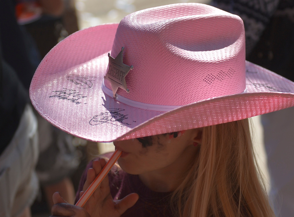 Justin Sheely | The Sheridan Press <br /> A young fan wears a Longmire hat during the sixth annual Longmire Days Saturday on Main Street in Buffalo, Wyoming. The show is based on local author Craig Johnson's novels set in the fictional town of Durant, inspired by the town of Buffalo. Longmire's sixth and final season will be on Netflix sometime this year.