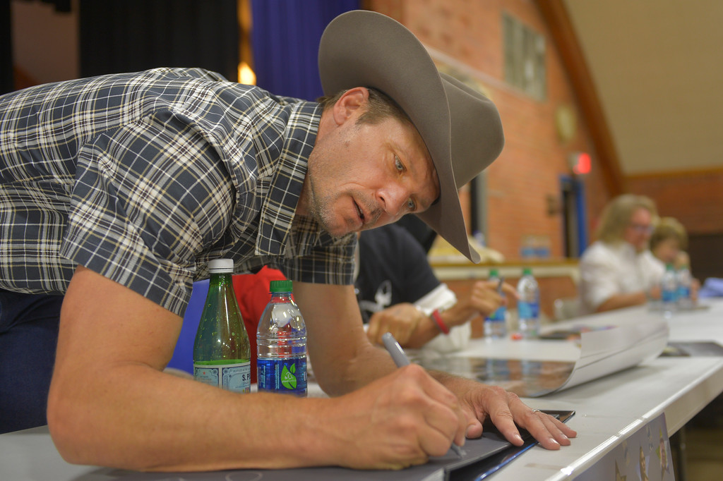 Justin Sheely | The Sheridan Press <br /> Longmire cast member Bailey Chase, Branch Connally, autographs for fans during the sixth annual Longmire Days Saturday at the Bomber Mountain Civic Center in Buffalo, Wyoming. The show is based on local author Craig Johnson's novels set in the fictional town of Durant, inspired by the town of Buffalo. Longmire's sixth and final season will be on Netflix sometime this year.