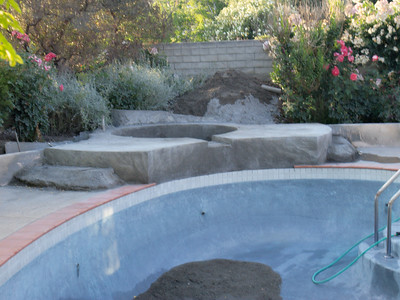 Believe it or not - this was the NEXT STEP - once the cage and the plumbing was in, the gunite folks came and did this.