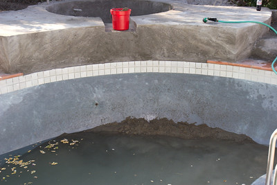 In order to spray the curve of the connection to the pool, they had to shoot gunite directly into the pool...