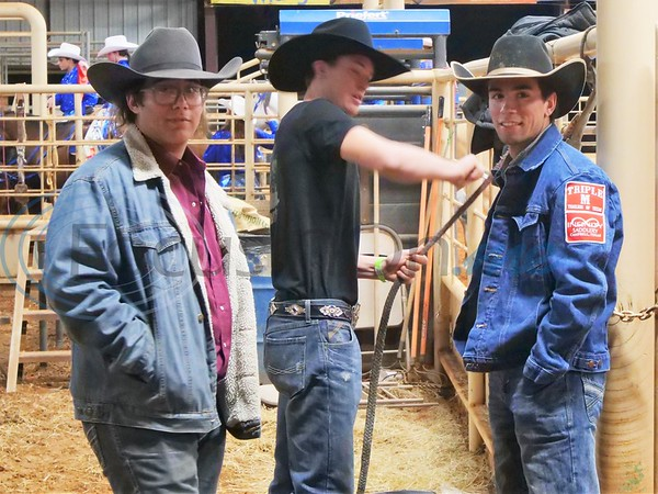 Bull Rider Prepares His Rope, With Help....