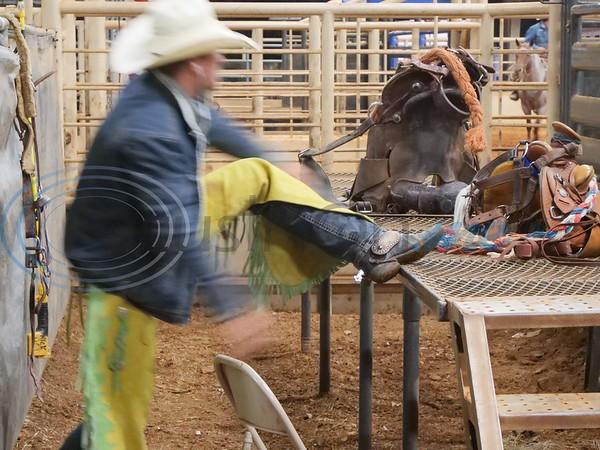 Saddle Bronc Rider getting ready.