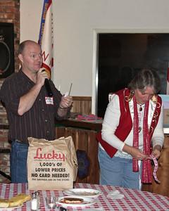 Nigel and Barbara picking the winning raffle ticket