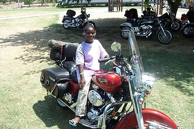 If I would have showed her how to start it ...she would have been long gone. This little Girl really wanted to ride my bike. Maybe in a few years.