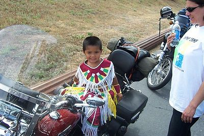 Greg a young Indian Boy we met on the ride up to Bass Lake After the visit to Champ Camp. Greg posed on my Bike with his Full Indian Dress. Lookin' good Greg.