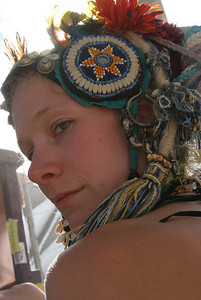 A playa girl with a Beautiful head piece.