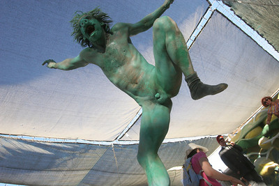 Green Painted man during the Burning Man Fashion Show