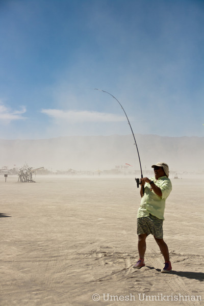 Some guy fishing in the desert