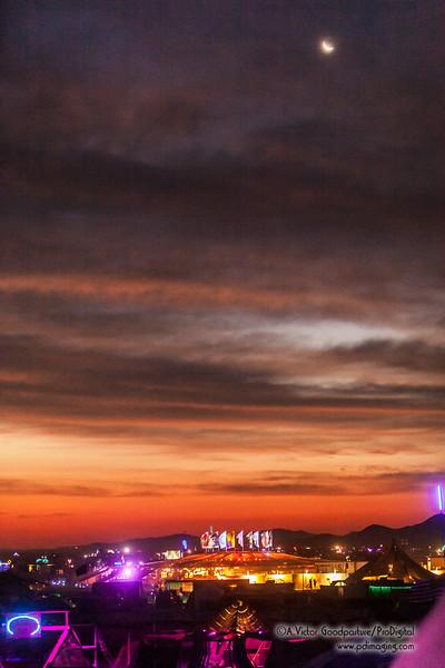 Moonset over sunrise at Burning Man