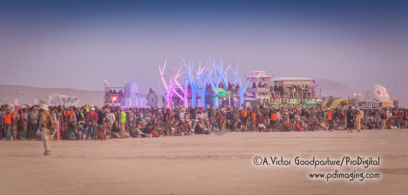 Burners began arrving hours before sunrise to get a front-row seat of burning Catacomb of Veils. Behind them are dozens and dozens of art cars; also called mutant vehicles.