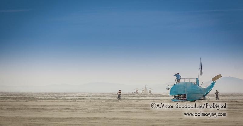 A blue whale on a white desert.