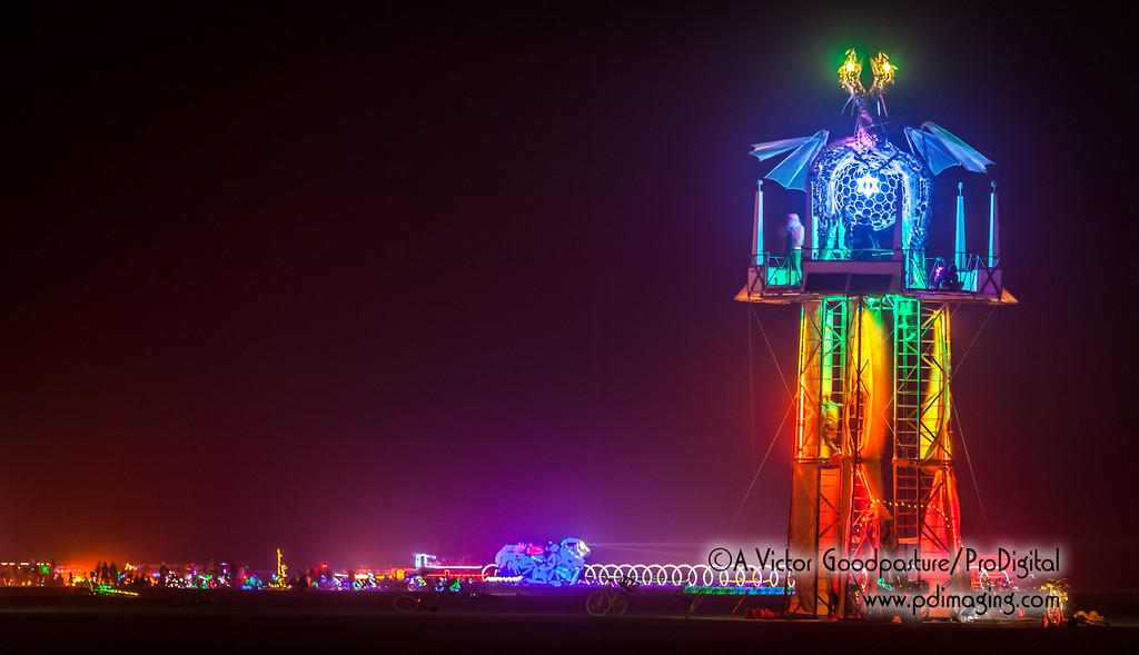 The Temple of Ascension with Sonic Runway in the background and the remains of the Black Rock Lighthouse Service (surrounded by revelers and art cars).