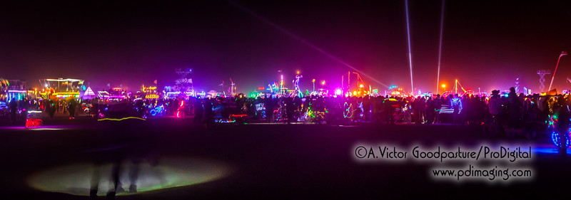 The carnival atmosphere was nothing I've ever witnessed before. The lights, sounds, music, people, commotion, fire, propane flames and general revelry engulfed my senses—and all the while a cold wind is blowing the very fine dust everywhere. In a word: Surreal.