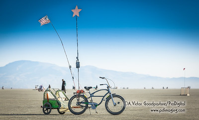 A bike trailer offers burners a way to be prepared for heat and cold while partying throughout the day and night; as well as having supplies of food and water.