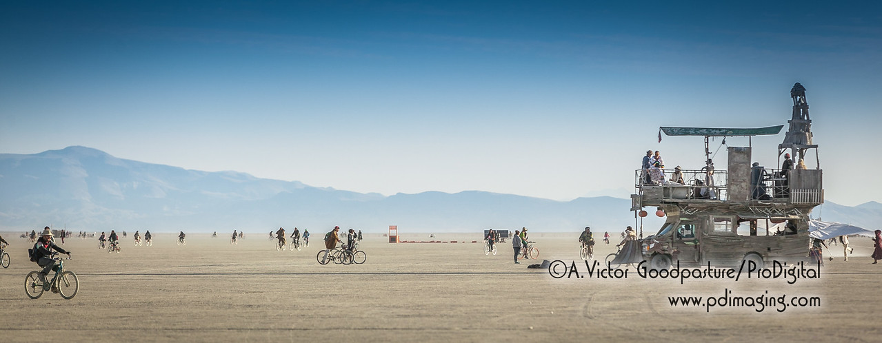 Saturday morning at sunrise, there is plenty of activity on the playa... people going back to their camps after partying all night.