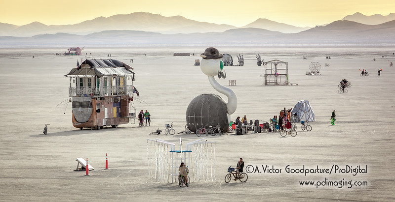 Art cars and bicyclists on the morning playa.