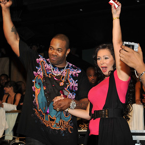 """Lana Fuchs, founder of  www.BillionaireMafia.com with Busta Rhymes in this photograph at Body English Nightclub inside Hard Rock Casino. Lana announced a partnership with Busta Rhymes and Billionaire Mafia. Lana sealed it with a priceless Godfather ring of clustered diamonds seen on Busta's left hand. High quality photo gallery of Busta Rhymes Concert in Body English Nightclub at Hard Rock Casino in Las Vegas Nevada. ISVodka was sponsor and hosted open bar for 2 hours with ISVodka shots and ISVodka martinis. Find more pictures for download at www.ISVodkaPhotos.com High quality photographs free download for personal use only with photo credit of """"Mark Bowers, Courtesy of ISVodka."""""""