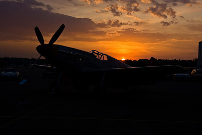 The sun setting behind the MN Wing's P-51C Mustang