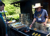 John Taylor cooks a burger to order for Dan Gluesenkamp (executive director of Cal Flora) at the chapter picnic at the EBRPD botanical garden in Tilden Park on Sunday.  Ironically -- or fittingly -- it was a fight to preserve this garden of California natives that led to the creation of CNPS 47 years ago.