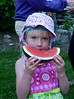 The youngest guest at the chapter picnic enjoys a slice of watermelon.