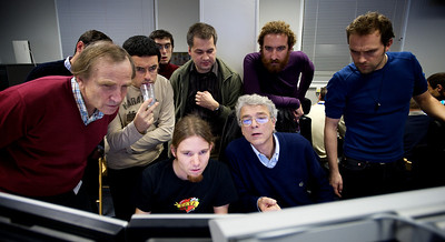 Spokesperson Jurgen Schukraft (front right) and collaborators studying the events of the first collision run in the ALICE control room.