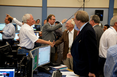 Lyn Evans being congratulated after the first beam went completely around the LHC.