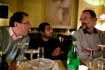 Andrey, Mitesh and Hans discussing, convenors dinner, Napoli, 2015.