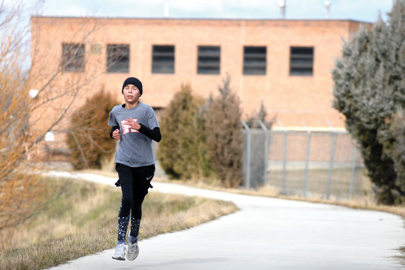 Matthew Gaston | The Sheridan Press<br>12-year-old Mariah Aragon toughs it out and is the first person to finish the CHAPS Ugly Sweater 5K in an impressive 22 minutes Saturday, Dec. 1, 2018.