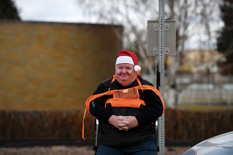Matthew Gaston | The Sheridan Press<br>Army veteran and CHAPS volunteer Eddie Paylor assisted in stopping traffic for Ugly Sweater 5k participants at Fort Road Saturday, Dec. 1, 2018.