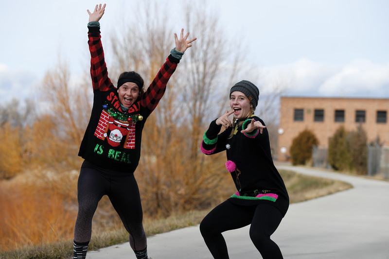 Matthew Gaston | The Sheridan Press<br>Rhyan Shultis left and Tannah Sellers right spontaneosly strike a pose in the middle of the CHAPS Ugly Sweater 5K Saturday, Dec. 1, 2018.