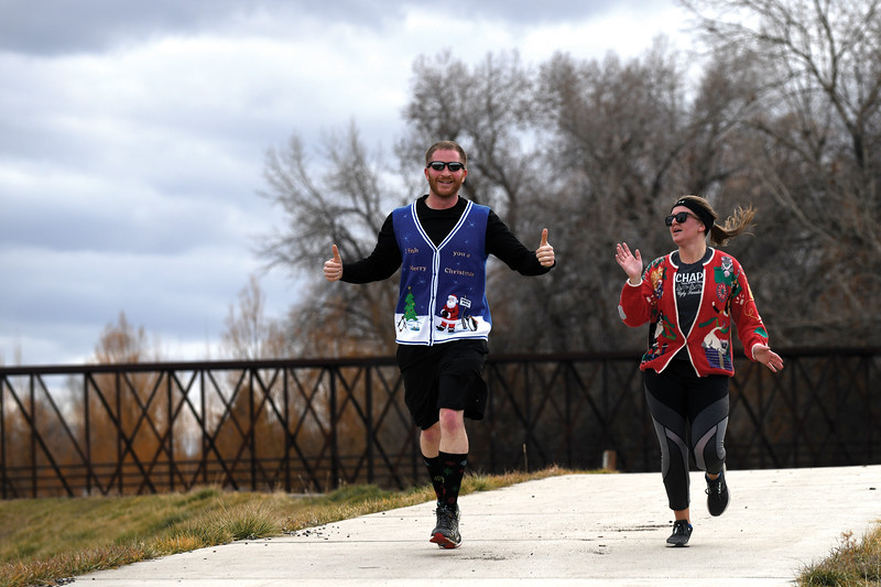 Matthew Gaston | The Sheridan Press<br>Jon Snoozy and Ashleigh Fox celebrate finishing the CHAPS Ugly Sweater 5K at Thorne-Rider Park Saturday, Dec. 1, 2018.