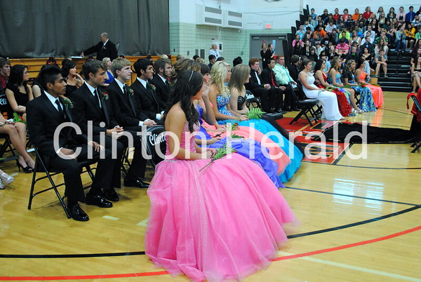 Clinton Homecoming candidates wait to hear the announcement of who was voted attendants, queen and king. • Katie Dahlstrom/Clinton Herald