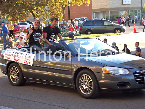 Clinton Homecoming Queen Rubina Vidal and Homecoming King Will Carr smile at the crowd at the Clinton Homecoming Parade on Thursday afternoon on Third Street. • Katie Dahlstrom/Clinton Herald