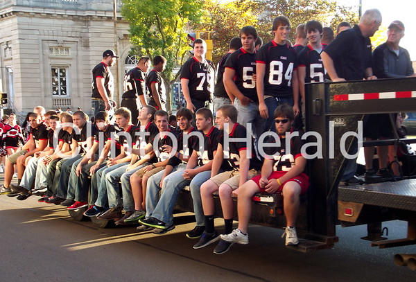 The River Kings football team makes it way down Third Street during the Homecoming parade on Thursday afternoon. • Katie Dahlstrom/Clinton Herald
