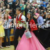 Clinton High School Homecoming King Will Carr and Homecoming Queen Rubina Vidal walk past their classmates after being crowned during the coronation ceremony Thursday morning at Clinton High School. • Katie Dahlstrom/Clinton Herald