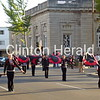 The Clinton High School Color Guard performs its way down third street during the Homecoming parade on Thursday. • Katie Dahlstrom/Clinton Herald