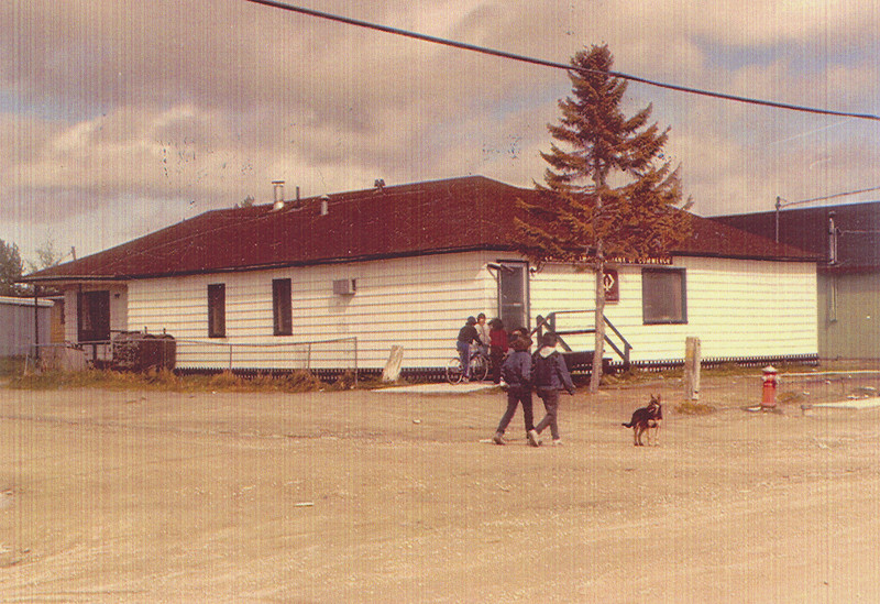 50th anniversary of Canadian Imperial Bank of Commerce (CIBC) branch in Moosonee. 1985 picture of bank from street with red fire hydrant.