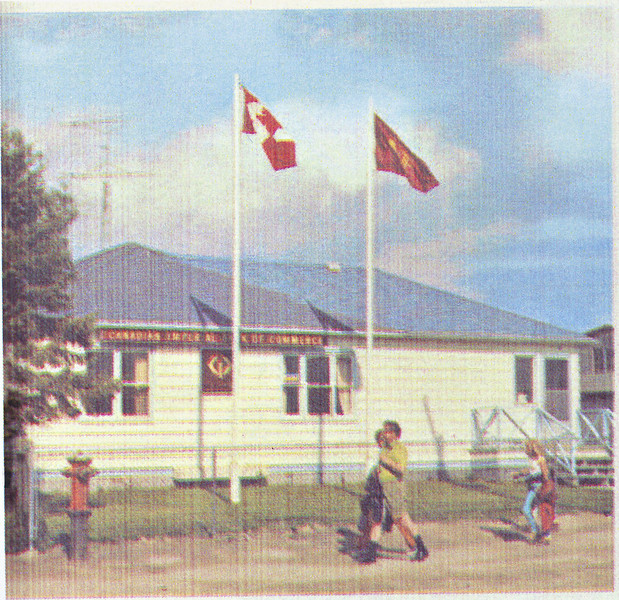 50th anniversary of Canadian Imperial Bank of Commerce (CIBC) branch in Moosonee.<br /> Inkjet print of image of bank showing Canadian and bank flags flying. Note red fire hydrant.