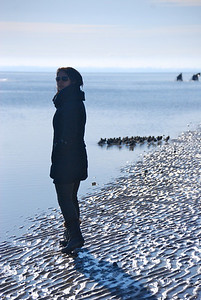 A student admires Utah Beach.